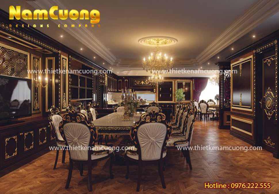 Ánh sáng vàng cho không gian phòng bếp ăn ấm cúng và tăng thêm độ sang trọng của nội thất gỗ