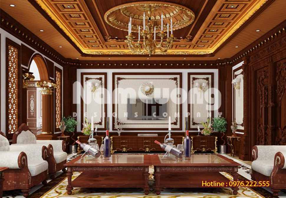 Phòng khách xa hoa, lịch lãm với nội thất chủ yếu sử dụng chất liệu gỗ quý theo sở thích của chủ nhân căn biệt thự nhà lâu đài ở ninh bình