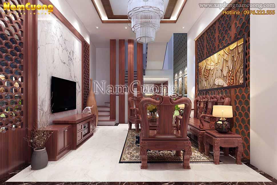 Phòng khách sang trọng, màu sắc nền nã, nội thất thiết kế tiện nghi, hiện đại.
