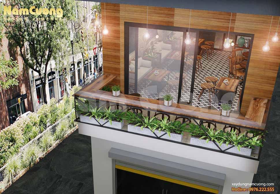 Góc ban công tầng 2 được phủ đầy màu xanh từ những ô trồng hoa cỏ