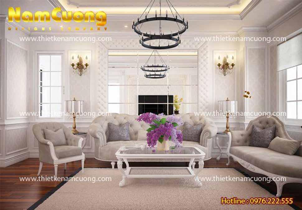 Phòng khách tân cổ điển bao phủ gam màu trắng trang nhã với bộ sofa sang trọng