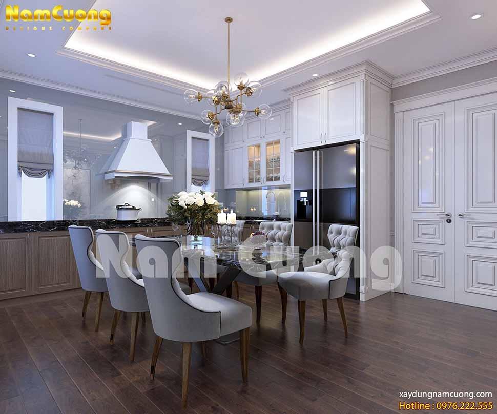 Nội thất phòng bếp thiết kế khách sạn tân cổ điển tại Lạng Sơn với gam màu chủ đạo là trắng và nâu gỗ đan xen