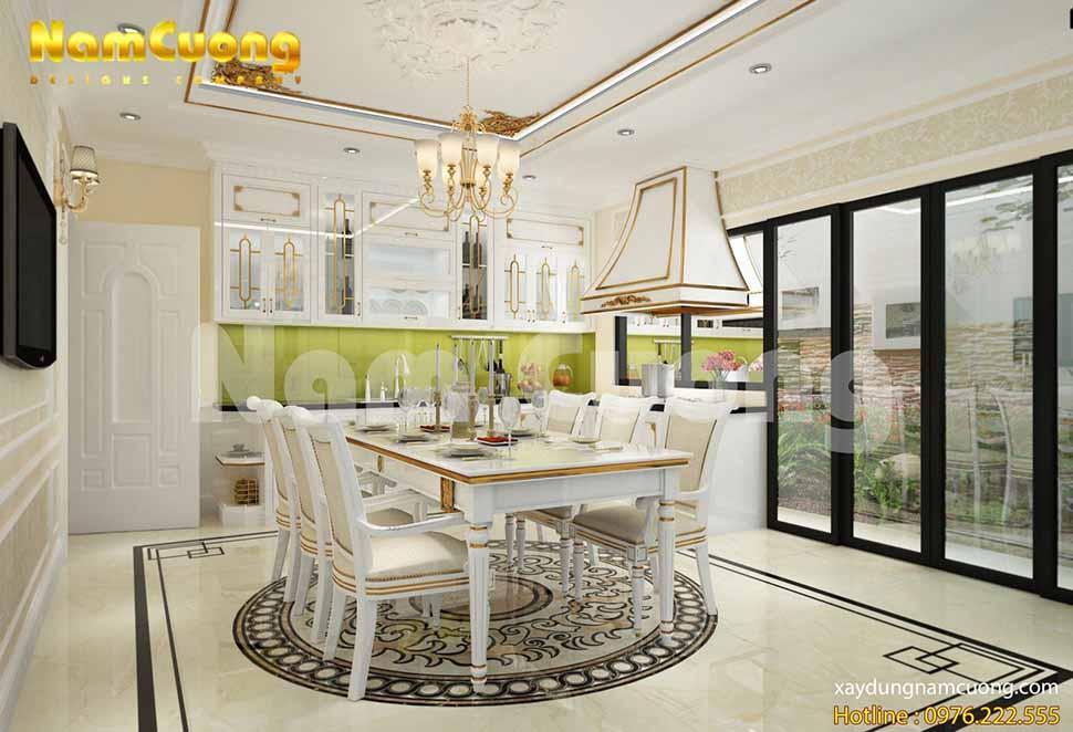 Sự kết hợp hoàn hảo giữa gam màu vàng và gam màu trắng của bàn ăn, tủ bếp